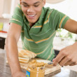 Royalty-Free Stock Photo: Teenage Male Making Peanut Butter Sandwich