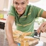 Teenage Male Making Peanut Butter Sandwich — Stock Photo #4782268