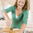 图库照片: Teenage Girl Making Peanut Butter Sandwich
