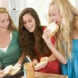 Teenage Girls Making Sandwiches - Stock Photo