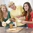 Teenagers Making Sandwiches - Stock Photo