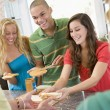 Stock Photo: Teenagers Making Sandwiches