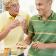 图库照片: Teenage Boys Making Sandwiches
