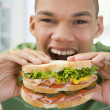 Teenage Boy Eating Sandwich — Stok fotoğraf