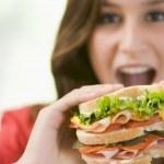 Teenage Girl Eating Sandwich — Stock Photo
