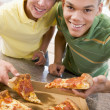 Teenage Boys Eating Pizza — Stock Photo