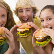Stock Photo: Teenagers Eating Burgers