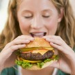 Teenage Girl Eating Burgers — Foto Stock