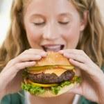 Teenage Girl Eating Burgers — Stock Photo