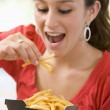 Teenage Girl Eating French Fries — Stock Photo