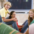 Teenagers Hanging Out In Front Of Television — Stock Photo