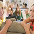 Stock Photo: Teenagers Hanging Out In Front Of Television