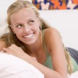 Teenage Girl Lying On Her Bed — Stock Photo #4782364