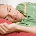 Teenage Boy Lying On Bed — Stock Photo #4782415