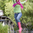 Teenage Girl Frolicking Outdoors — Stock Photo #4782427