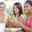 Teenage Girls Sitting Outdoors Eating Fast Food — Stock Photo