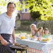 Stock Photo: Family Enjoying A Barbeque