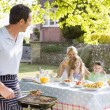 Royalty-Free Stock Photo: Family Enjoying A Barbeque
