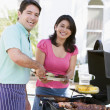Stock Photo: Couple Cooking On A Barbeque
