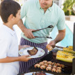 father and son barbequing — Stock Photo #4784925