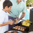 father and son barbequing — Stock Photo #4784928