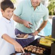 father and son barbequing — Stock Photo #4784931
