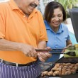 Couple Cooking On A Barbeque — Stock Photo