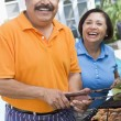 Royalty-Free Stock Photo: Couple Cooking On A Barbeque