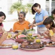 Family Enjoying A Barbeque — Stock Photo #4784968