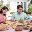 Family Enjoying A Barbeque — Stock Photo #4784970