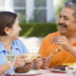 Couple Enjoying A Barbequed Meal In The Garden — Stock Photo