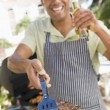Man Barbequing In A Garden - Foto de Stock  