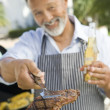 Man Barbequing In A Garden — Stockfoto