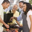 Family Enjoying A Barbeque — Stock Photo #4785012