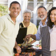 Family Enjoying A Barbeque — Stock Photo #4785013