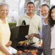 Family Enjoying A Barbeque — Stock Photo #4785014