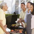 Family Enjoying A Barbeque — Stock Photo #4785016