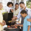 Family Enjoying A Barbeque — Stock Photo #4785017