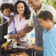 Family Enjoying A Barbeque — Stock Photo #4785020