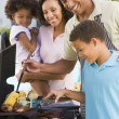 Family Enjoying A Barbeque — Stock Photo #4785021
