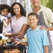 Family Enjoying A Barbeque — Stock Photo #4785024