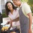 Stock Photo: Couple Cooking On Barbeque