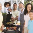 Family Enjoying A Barbeque — Stock Photo #4785033