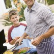 father and son barbequing — Stock Photo #4785035