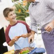 father and son barbequing — Stock Photo