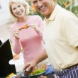Couple Cooking On A Barbeque — Stock Photo #4785047