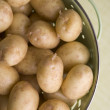 Stock Photo: New Potatoes In Colander