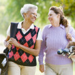 Female Friends Enjoying A Game Of Golf — Stock Photo #4785230