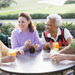 Stock Photo: Friends Enjoying A Beverage By A Golf Course