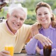 Stock Photo: Couple Enjoying A Beverage By A Golf Course